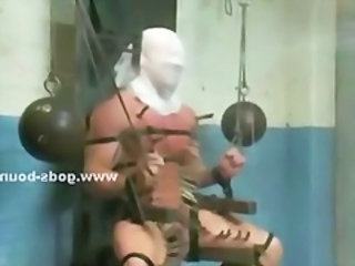 Muscular and masked gay males get tied up and suspended while forced to kiss each other