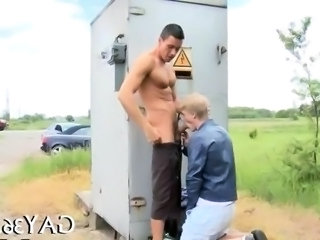Two gay fellows enjoy a public blowjob