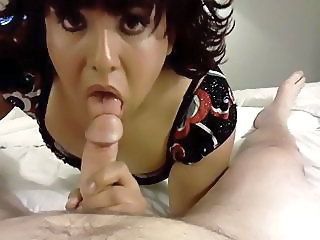 Crossdresser sucking huge cock