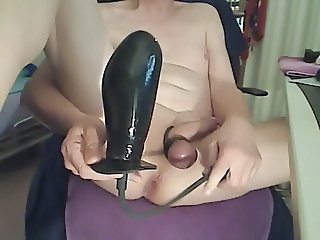 Huge inflatable dildo in tight shaved asshole